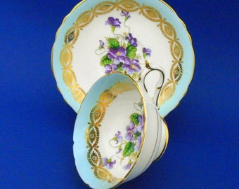 Paragon purple Violets art deco turquoise Tea cup and saucer glittering gold gilt