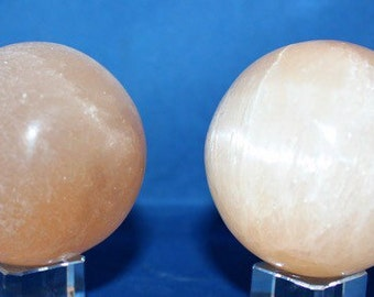 Red Polished Selenite Sphere range in size from 50-60mm.es