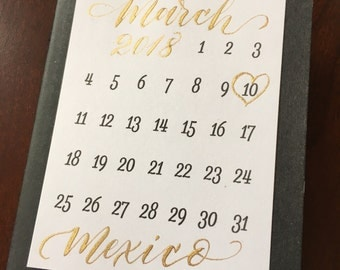 Personalized mini save the date calendar with location of wedding - gold ink