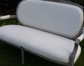Large Antique, Vintage French Sofa Love Seat reupholstered with a French Linen monogrammed sheet Circa 1900-1910.