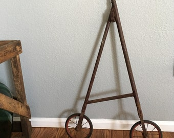 Extremely Rare Antique Cane-form Metal Wheeled Package/Bag Carrier