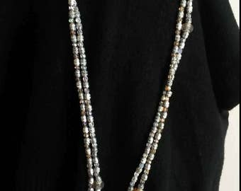 crystals and silver dividers for this double length 110 cm necklace