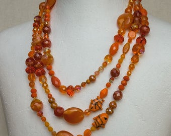 Long orenge necklace in Bohemian glass
