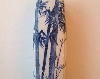 Blue and white japanese vase with blue bamboo decoration