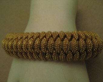 Signed Panetta Wide Domed Gold Tone Metal Honeycomb Designer Bracelet With Safety Chain