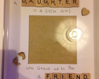 A Daughter is a little girl who grows up to be a friend. Mothers Day picture frame gift