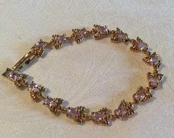 Vintage Avon bracelet gold tone angel with pink rhinestones Superb