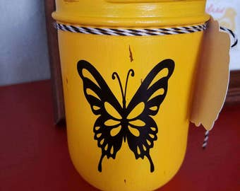 Hand Painted and Distressed Mason Jar in yellow color with butterfly