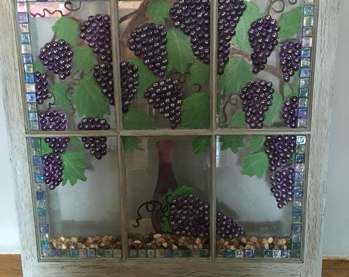 Old window with grape vine decor