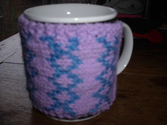 A hand knitted mug hug / mug cosy