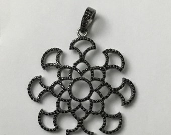 Black spinal sterling silver charm