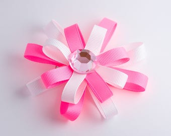 pink and white hair bow with gem center