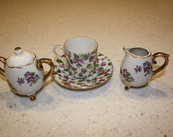 Violet tea cup with sugar and creamer