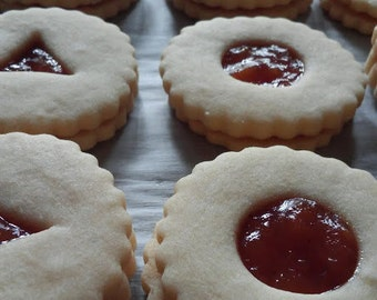 A Dozen of Homemade German Linzer Cookies in a tin box, made from scratch - your own choice of jelly
