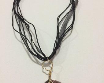 Rhodonite pendant with ribbon cords