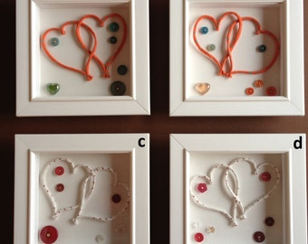 Love Tokens (a, b c or d) – Repurposed mixed media incorporating buttons, fabric and glass heart.