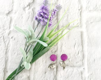 Exotic silver earrings with cerise purple bead and koi fish charm.