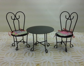 Ornamental wrought iron, hand made , barbie sized table and chairs.