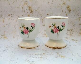Vintage floral porcelain eggcups with gold trim