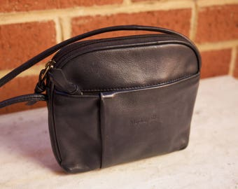 Classic small dark navy cross-body bag with multiple compartments and gold detailing