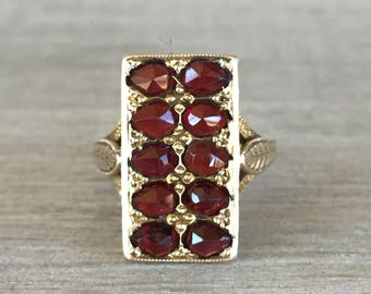 Rose cut vintage garnet ring in yellow gold