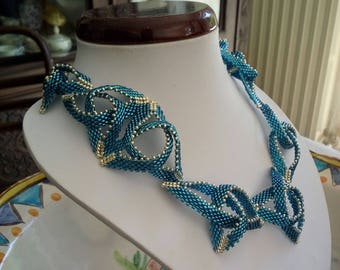 Necklace composed of Celtic knots made using Delica beads