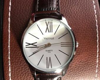 A Lovely Business Style Watch With A White Face And A Light Padded Strap