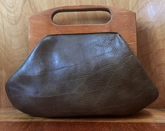 Sweet little leather handbag with wooden hinge-top handle, by Tuerks, Baltimore, MD
