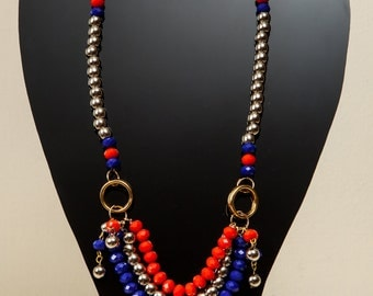 Beaded orange, blue and silver necklace.