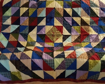 Fun scrappy throw quilt.