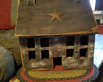 Black salt box house with star