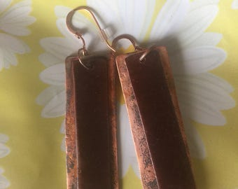 Handmade and hammered copper earrings.