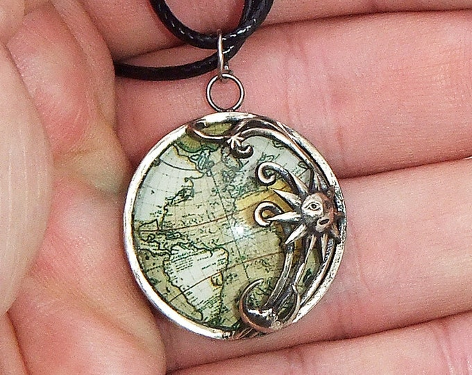 """Pendant """"Sun and Moon over the land"""" made of bronze with a glass lens"""