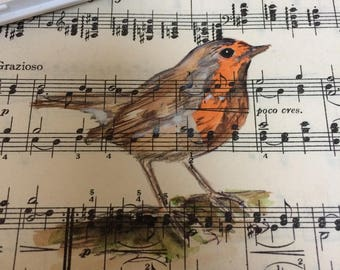Robin Red Breast on vintage sheet music and in an antique frame