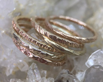 Gold stacking rings with hammered textures