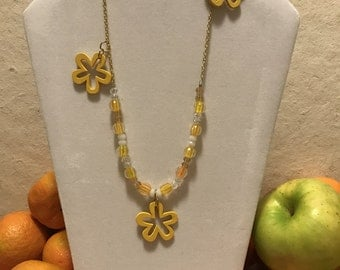 Yellow and clear beaded necklace with three yellow flowers
