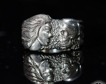 Life and death  ring. For mens of sterling silver. With face of the girl and a human skull.