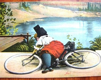 PORT CANCEL Rare 1913 Litho Color Postcard Schaumburg COUNTRY Costumed Woman on Bicycle