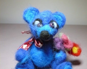 Blue bear with bouquet
