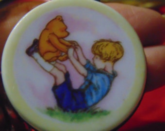 Midwest of CannonFalls Classic Winnie the Pooh and Christerphor Robin  playing together on this trinket box