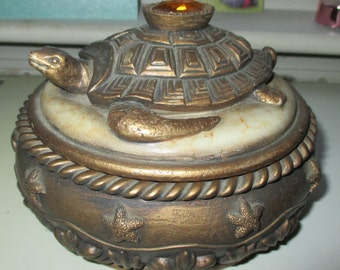 """A turtle round box for treasures,amber color jewel knob,cocoa brown suede lining, 6"""" dia.4.5"""" high"""