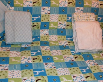 Baby boy flannel quilt with coordinating crib sheets