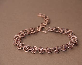 Bangle of patinated copper