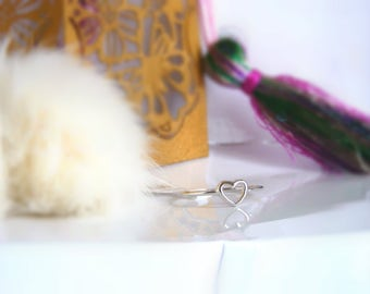 Hollow heart in sterling silver and sterling silver bathed in gold and circle-shaped ring