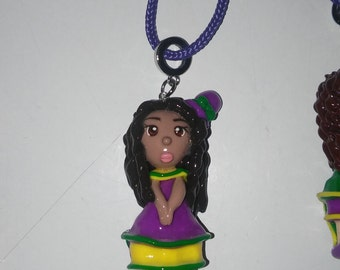 Mardi Gras Girl Clay Pendant on Purple Rope