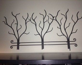 Metal wall art w/ black patina finish