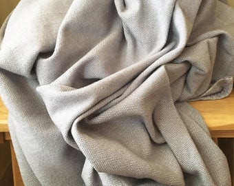 Great coverage of quality acrylic wool. Entirely at the loom. All gray. Super soft and warm.  Wool blanket.