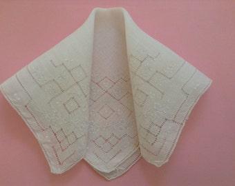 Hand embroidered linen handkerchief.