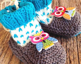 Handmade knitted spotted baby booties with owl buttons