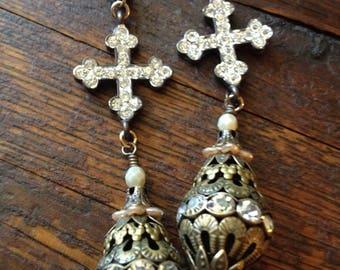 Brass filigree and rhinestone beads dangle from rhinestone pave cross earrings
